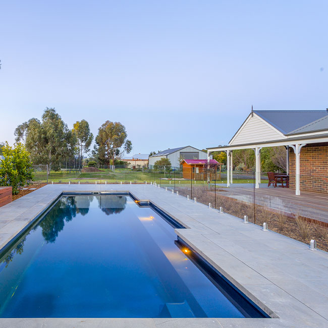 A picture of bluestone pavers around a pool in Melbourne.