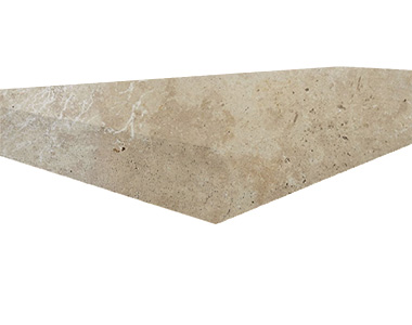 Travertine pool coping with a square tumbled edge