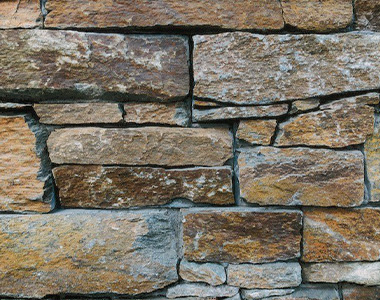 Brown rock wall, feature walls melbourne, stone wall cladding