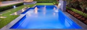 This fibreglass swimming pool has utilised Bluestone Pool Coping Pavers with a 40mm drop face, along with a bluestone waterfeature