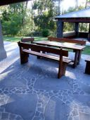 Bluestone Crazy Paving shown in this outdoor BBQ area