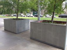 Bluestone Tiles shown outside on planter boxes looking very creative