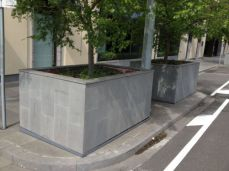 Outdoor Bluestone Paving is shown here on these planter boxes and pathway