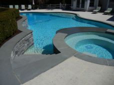 These Outdoor Bluestone Pavers around the pool and on the steps are a non slip finish