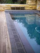 Bluestone Pool Pavers have been put around this Swimming Pool