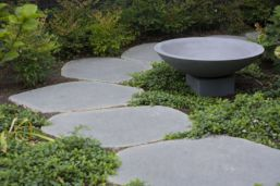 Sawn and lightly honed Bluestone Stepping stone Pavers laid on this outdoor lawn