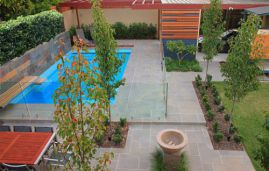 Sawn and lightly honed outdoor Bluestone Pavers that have been laid in a modula pattern