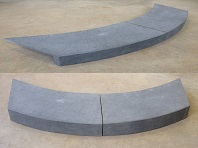 L shaped pool coping and white stone pavers