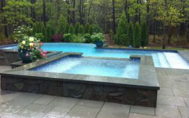 Bluestone Pool Coping with matching Bluestone Pavers in ashlar pattern