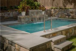 Square edge Bluestone Pool Coping with Ledgestone retaining walls