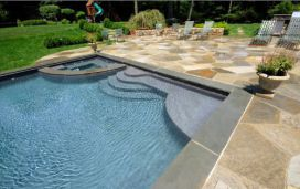 Bluestone Pool Coping contrasting with quartz crazy paving