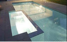 Bluestone Pool Coping and Paving coated in Enhancing sealer for a darker look