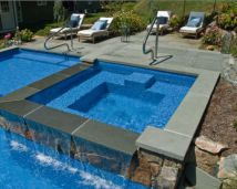 Square Edge Bluestone Pool Coping,matching Bluestone Pool Pavers contrasting with Ledgestone Feature Wall