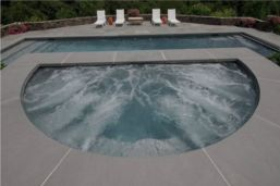 Pool and Spa area paved in Bluestone square edge Pool Coping