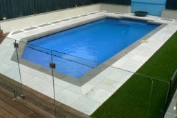 Bluestone Pool Coping contrasting with White Granite Pool Pavers