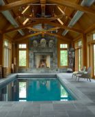 Indoor Pool paved with Modular Pattern Limestone Pool Pavers and matching Pool Coping