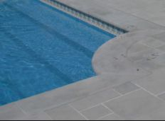 Bullnosed Bluestone Coping Tiles with matching modular Pool Paving