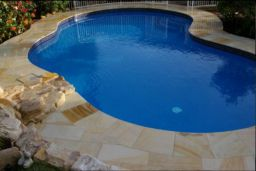 Natural Split Sandstone Pool Paving with matching Bullnosed Pool Coping