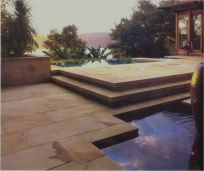 Indian Sandstone pool pavers in brick bond pattern with matching pool coping