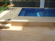 Teak Sandstone Pool Tiles with matching Pool Coping and stairs
