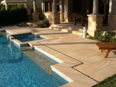 Teak sandstone Pool Pavers and Pool coping in outdoor setting
