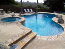 Natural Split Sandstone Crazy Paving used as Pool Coping and stair treads