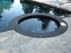 Travertine Pool Pavers with contrasting Midnight Black Granite Pool Coping Tiles