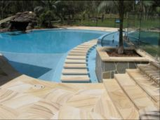 Teakwood Sandstone Pool Coping and Paving with Floating Stairs