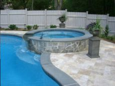 Bullnosed Bluestone Pool Coping with Travertine Pool Pavers contrasting with feature wall on spa