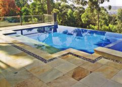 Natural Split Sandstone Pool Coping and Paving with Enhance sealer to deepen the colour
