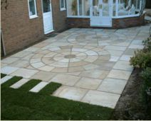 Sandstone Pavers with a natural split finish surface laid in a courtyard