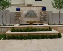 Honed Sandstone Pavers laid in a flagstone pattern with honed bullnose pavers