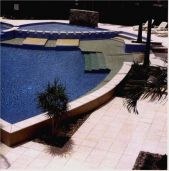 Sandblasted sandstone pavers and square edge pool coping pavers.