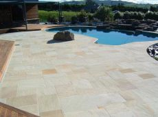 Natural split surface sandstone paving and pool coping