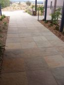 Natural split sandstone pavers with a non slip surface laid on this outdoor pathway