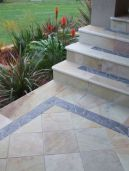 Outdoor natural split surface sandstone pavers with a bluestone border