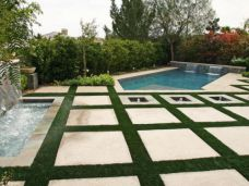 Large Format Sandstone pavers used as stepping stones and pool edging