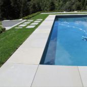 Large pool coping in a honed/smooth Sandstone Paver with a non slip surface for around a pool
