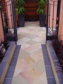Natural split Sandstone Pavers laid on this pathway with a bluestone border