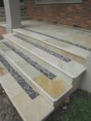 Natural split surface non slip Sandstone Paving and bullnose edge pavers with a bluestone border