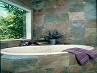 Multicolour Slate Tiles around a Spa Bath