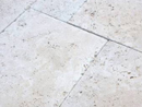 Unfilled and tumbled travertine pavers