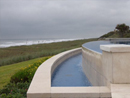 Ivory travertine pool coping unfilled and tumbled with a square edge