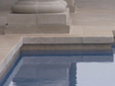 Ivory drop face pool coping and matching pavers