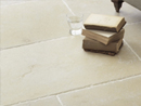 Ivory Travertine floor tiles that have an unfilled and Chiseled edge finish